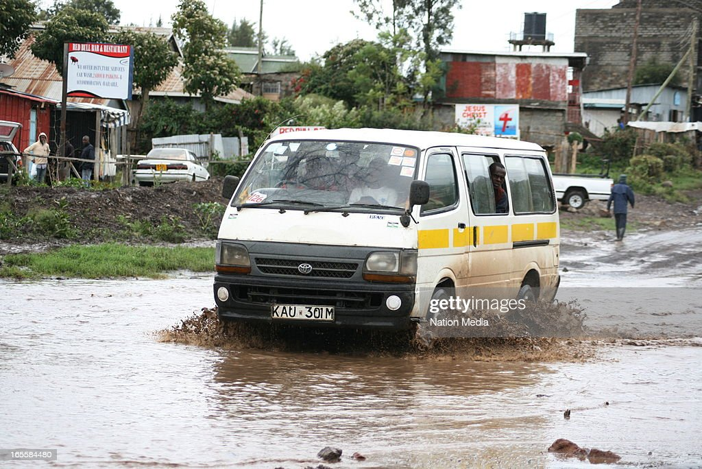 A taxi makes its way through flooded water on April 1, 2013 in Nairobi, Kenya. Thousands of people have been displaced by the heavy rains with houses destroyed and livestock lost. At least 10 people have reportedly been killed by the floods.