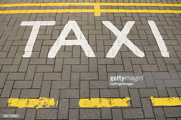 Taxi markings on road