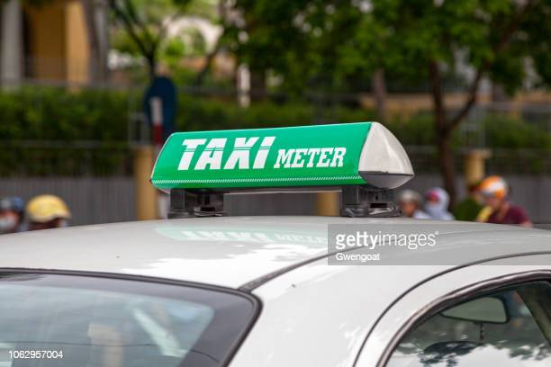 taxi meter sign in hanoi - gwengoat stock pictures, royalty-free photos & images