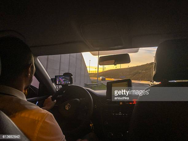 Taxi moving on a road to Paris from Airport, France