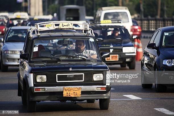 taxi on the street of city of cairo - kairo stock-fotos und bilder