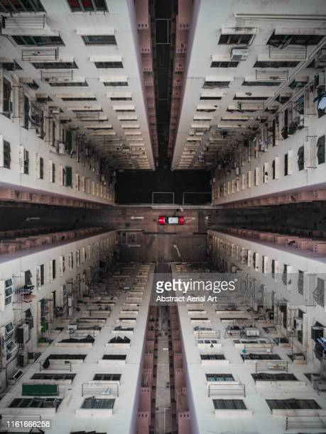 Taxi parked at the bottom of a building atrium, Hong Kong