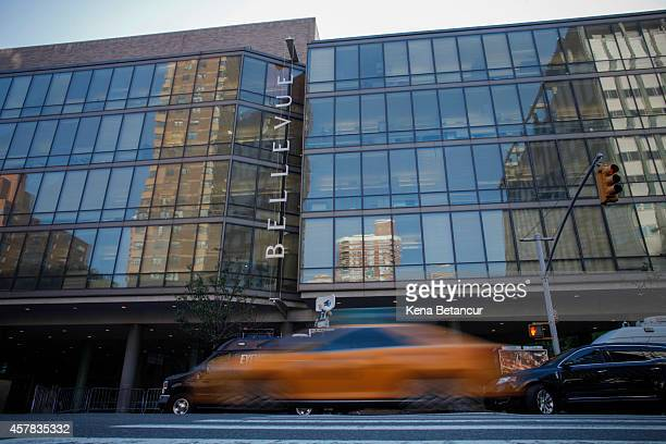 A taxi passes in front of Bellevue Hospital where Dr Craig Spencer who was diagnosed with the Ebola disease remains in quarantine on October 25 2014...