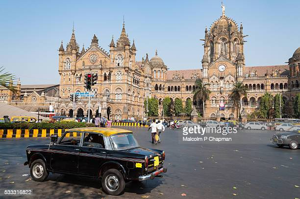 Taxi passes in front of Chhatrapati Shivaji Terminus, Mumbai