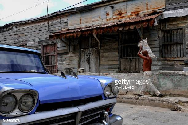 A taxi remains parked in Havana on April 19 day in which Miguel DiazCanel was formally named Cuba's new president and thus succeeding Raul Castro...