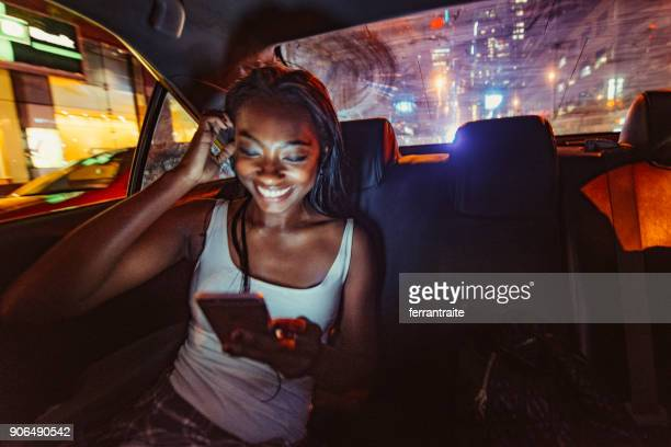 taxi ride in new york city - nightlife stock pictures, royalty-free photos & images