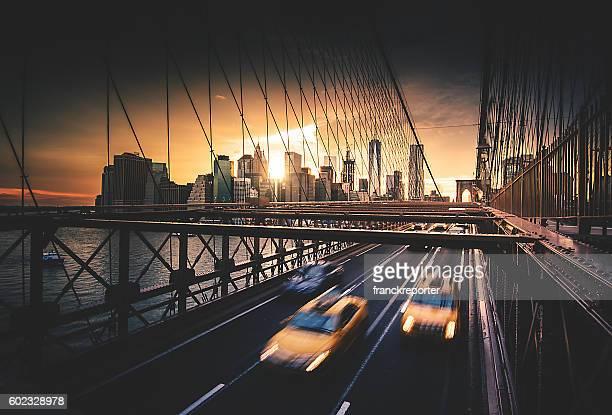 taxi running fast on nyc brooklyn bridge