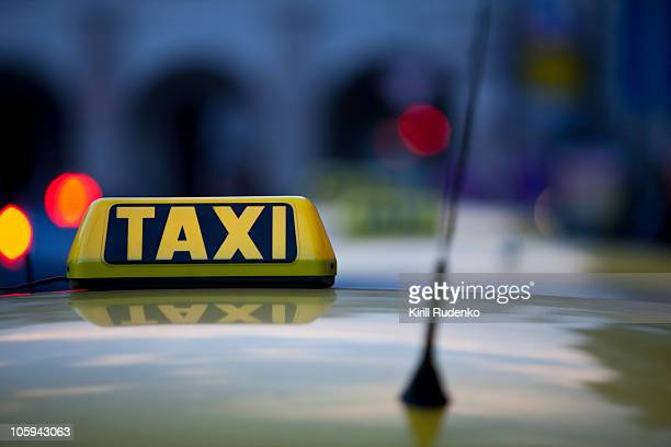Taxi sign and reflections at night