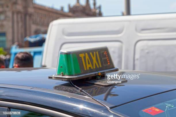taxi sign from barcelona - gwengoat stock pictures, royalty-free photos & images