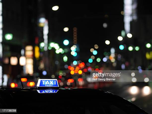Taxi sign on a cab at night in Tokyo's district Roppongi