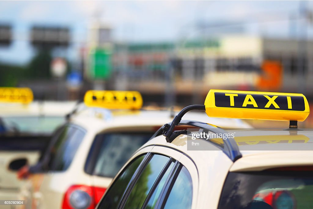 Taxi signs - cars waiting for passenger : Stock Photo