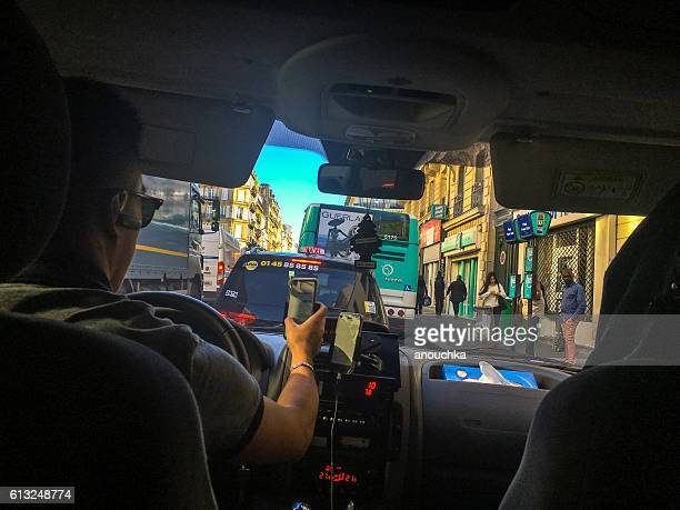 Taxi stuck in traffic jam, Paris, France