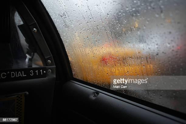 taxi through wet car window - wasserform stock-fotos und bilder