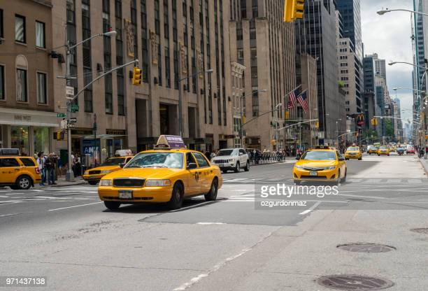 taxi traffic new york city, usa - yellow taxi stock pictures, royalty-free photos & images
