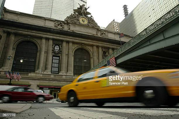 A taxi turns in front of Grand Central Station October 22 2003 in New York City Grand Central Station which opened in 1913 is celebrating its 90th...