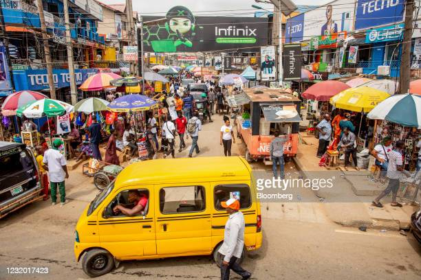 Taxi van drives past the entrance to the Ikeja computer village market in Lagos, Nigeria, on Monday, March 29, 2021. Nigerians are having to contend...