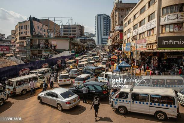 Taxi vans and automobiles sit in heavy traffic in downtown Kampala, Uganda, on Tuesday, June 23, 2020. Uganda has enforced restrictions for almost...