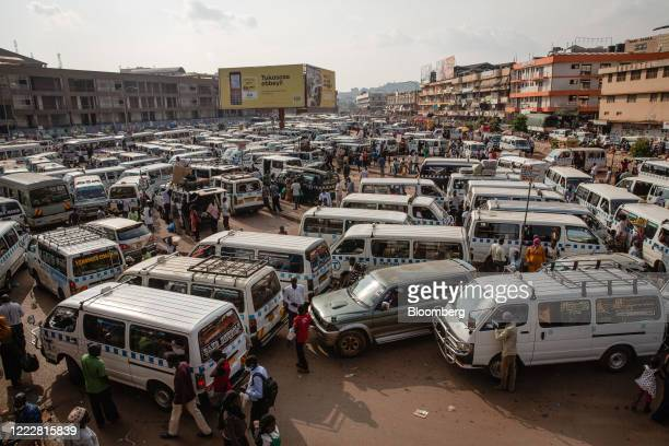 Taxi vans sit in the ground of the New Taxi Park in downtown Kampala, Uganda, on Tuesday, June 23, 2020. Uganda has enforced restrictions for almost...