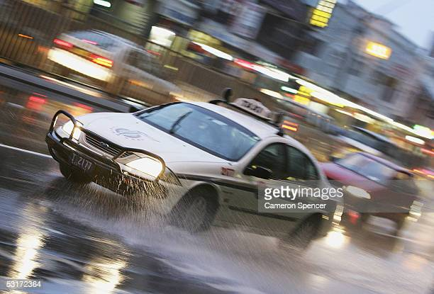 A taxi wades through water flooding the Pacific Highway as heavy rain continues to fall across Sydney June 30 2005 in Sydney Australia The consistent...
