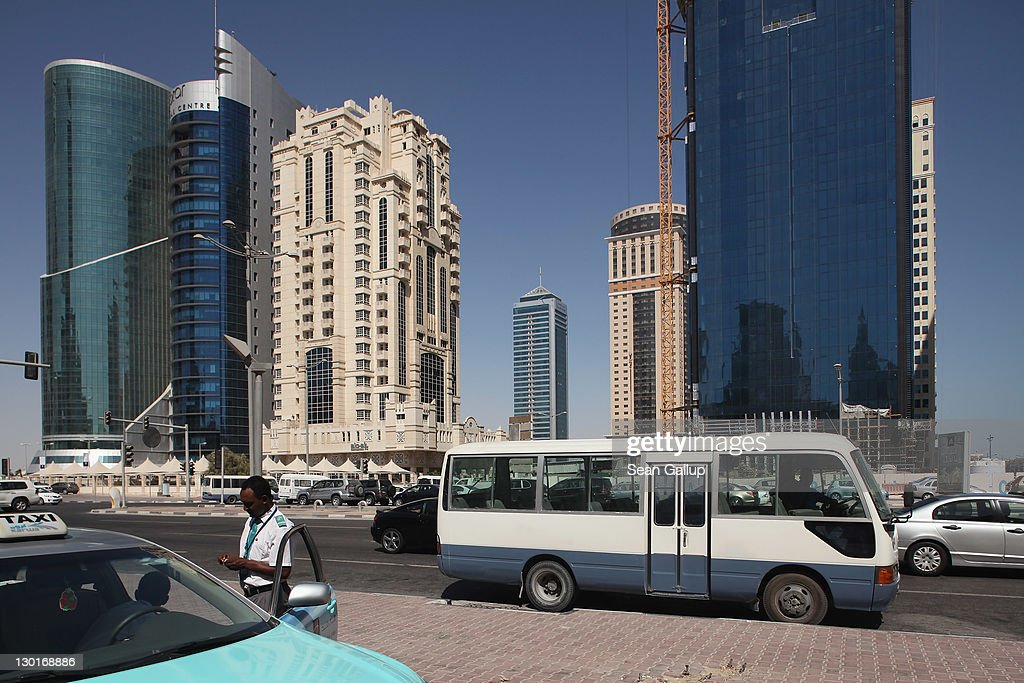 A taxi waits for passengers among new skyscrapers in the budding new financial district on October 23, 2011 in Doha, Qatar. Qatar will host the 2022 FIFA World Cup football competition and is slated to tackle a variety of infrastructure projects, including the construction of new stadiums.