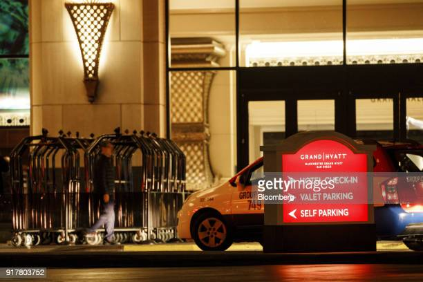 A taxi waits outside the Manchester Grand Hyatt Hotel in San Diego California US on Sunday Feb 11 2018 Hyatt Hotels Corp is scheduled to release...