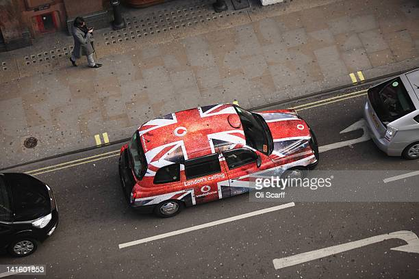 A taxi with union flag livery travels along Shaftesbury Avenue in the West End on March 19 2012 in London England London's West End is synonymous...