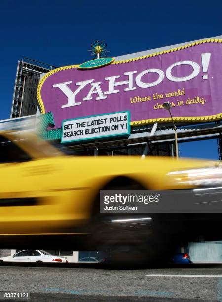 A taxicab drives by a Yahoo billboard October 21 2008 in San Francisco California Yahoo announced today that it will cut at least 1400 jobs from from...