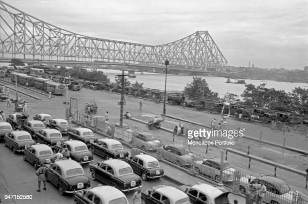 Taxicabs in a row near the Howrah Bridge along the Hooghly river Kolkata 1962