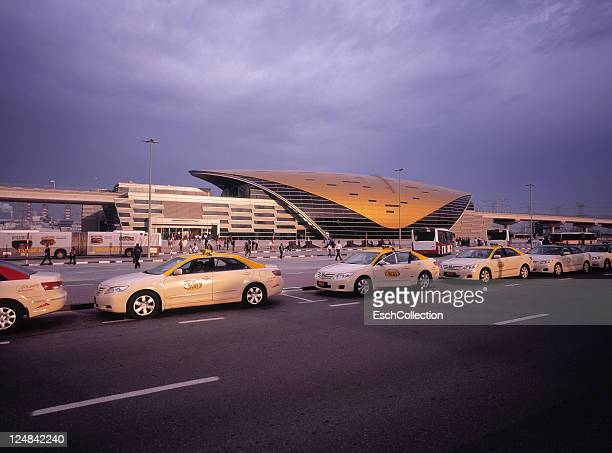 Taxicabs waiting at futuristic metro stop in Dubai