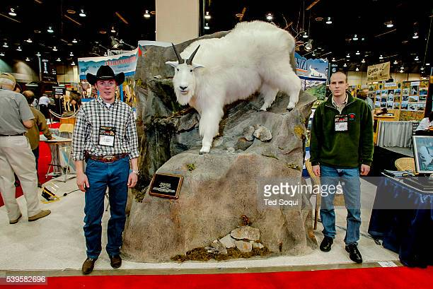 Taxidermied Lion with the hunter and taxidermer The Safari Hunters Club convention 2004 held in Reno Nevada The annual event features the latest in...