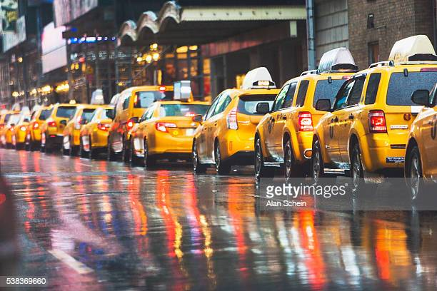 taxies in a row, new york city - taxi stock pictures, royalty-free photos & images