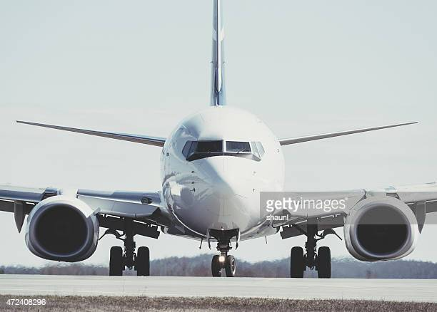 taxiing passenger jet - front view stock pictures, royalty-free photos & images