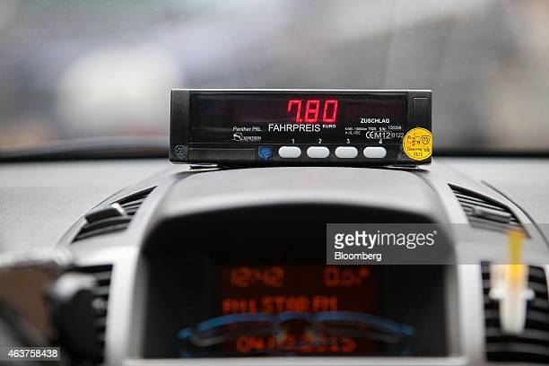 A taximeter displays fare calculations as it sits on the dashboard of a taxi operated by Leipold Taxibetrieb in Berlin Germany on Wednesday Feb 4...