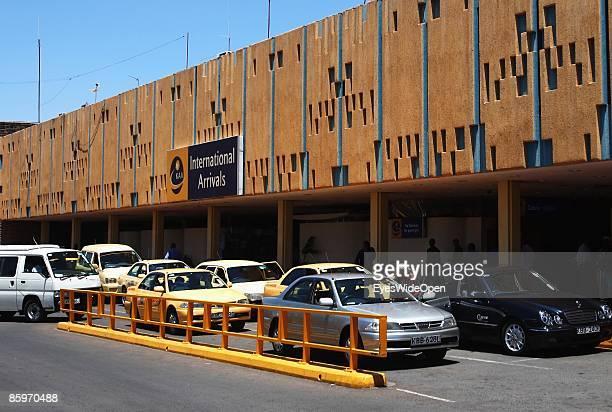 Taxis and cars in front of Jomo Kenyatta International Airport Nairobi on March 20 Nairobi Kenya