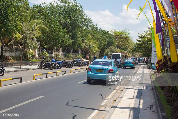 Taxis and Motorbikes on a Kuta Street