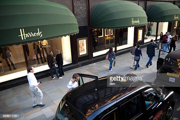 Taxis and Pedestrians in Front of Harrods Department Store, London
