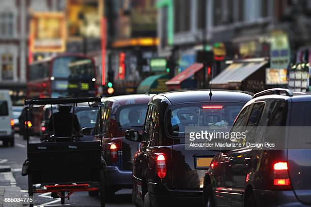 Taxis and traffic on Shaftsbury Avenue
