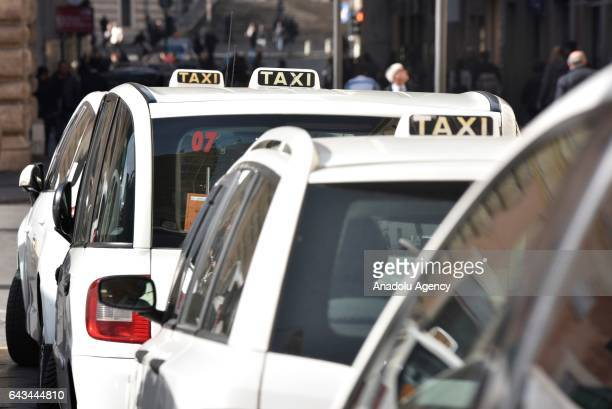 Taxis are parked during taxi drivers' strike to protest the amendment on appbased car transport company Uber in Rome Italy on February 21 2017