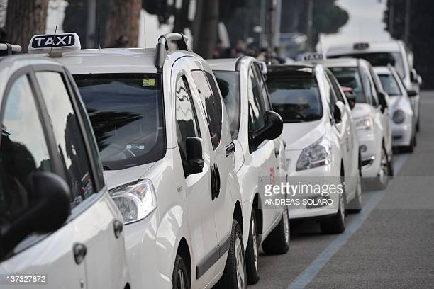 Taxis are parked near the Circus Maximus during a protest on January 18 2012 in Rome Italian taxi unions announced a national strike for January 23...