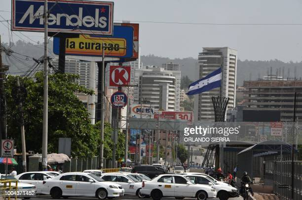 Taxis block a boulevard during a transport strike in Tegucigalpa on July 23 2018 Honduran carriers blocked roads demanding the government to lower...