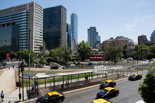 Taxis drive down a street in the financial district of Santiago Chile on Wednesday Dec 3 2014 Chilean unemployment unexpectedly fell in the three...