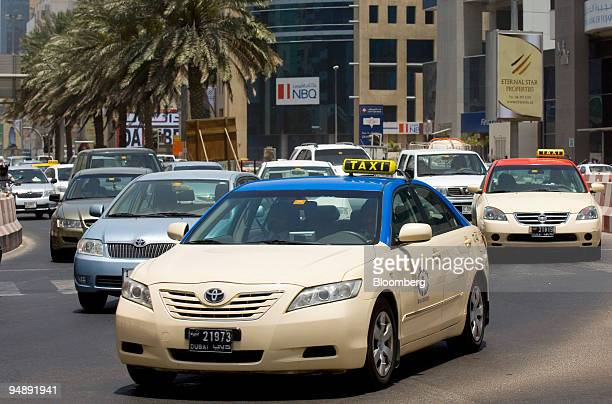 Taxis drive down Bank Street in Dubai United Arab Emirates on Thursday May 22 2008 About 6000 taxis and 500 buses serve more than six million...