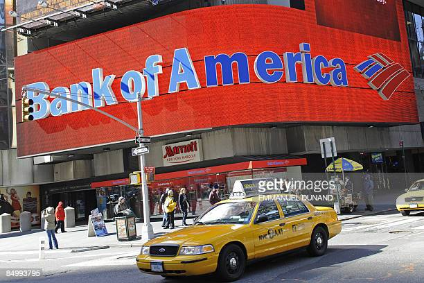 Taxis drive past a Bank of America branch in New York on February 23 2009 US authorities unveiled details of a new aid plan for struggling banks that...