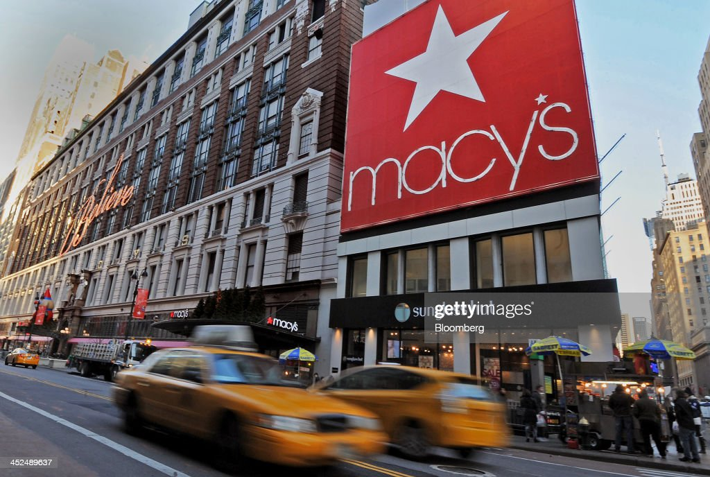 Taxi's drive past Macy's Inc. flagship store in New York, U.S., on Thursday, Nov. 29, 2013. Terry Lundgren, president and chief executive officer of Macy's Inc., said 15,000 shoppers waited to enter its Herald Square store in New York at 8 p.m. last night, up from 11,000 at midnight a year earlier. Photographer: Peter Foley/Bloomberg via Getty Images