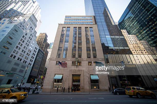 Taxis drive past the Tiffany and Co flagship store in New York US on Tuesday March 18 2014 Tiffany Co is expected to release earnings figures on...