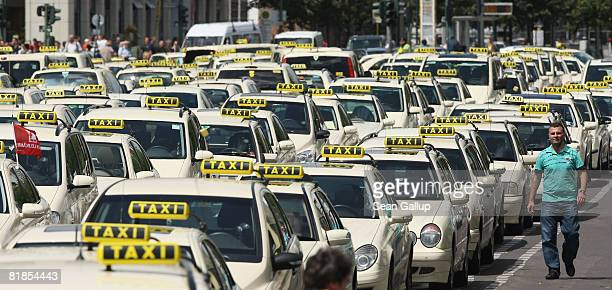Taxis from protesting taxi drivers stand parked in the street at City Hall during a demonstration against rising gasoline prices on July 8 2008 in...