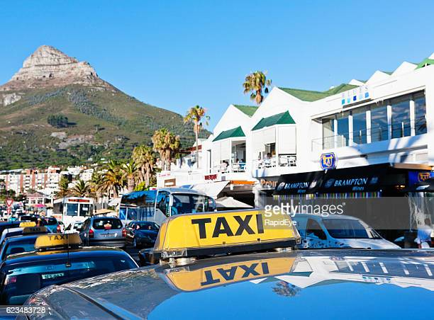 Taxis in busy vacation destination Camps Bay, Cape Town