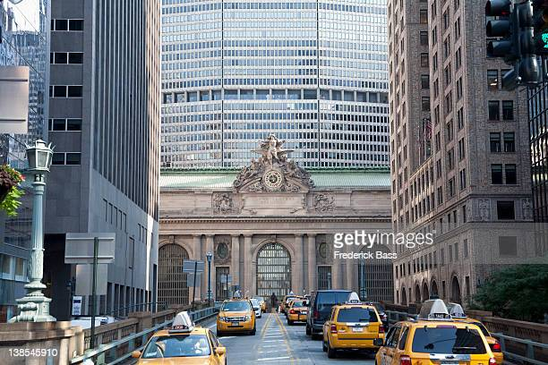 taxis in front of grand central station, new york city - grand central station stock photos and pictures