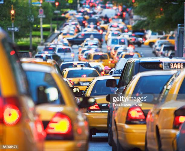 taxis in rush hour traffic - traffic stock pictures, royalty-free photos & images