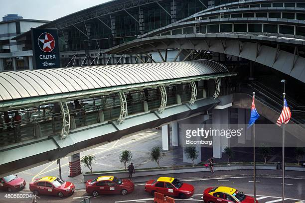Taxis line up to wait for customer at the Johor Bahru Sentral station in Johor Bahru Johor Malaysia on Friday July 10 2015 The ringgit has fallen 76...